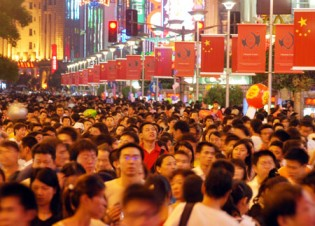 Patriotism: Chinese citizens gathering in the streets for China's National Day celebration. The Chinese Communist Party's rule significantly undermined the nation's education system.
