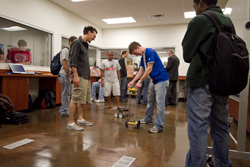 Engineering students at work in the new robotics lab inside the James D. Hughes Center.