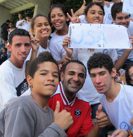 Union soccer player Diego Santos (in the red jersey) poses for a photo with some students from a deaf institute in Rio de Janeiro.